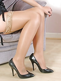 These stockings look gorgeous covering this sexy blondes..