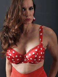 Sexy red polka dot bra holds Nylon Janes big tits in place