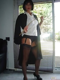 Teacher Jane spanks naughty Tgirl in school uniform