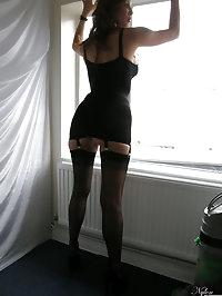 Nylon Jane showing off her tight body in black lingerie