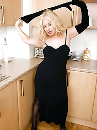47 year old Caresse hams it up while getting naked in the..