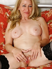 50 year old MILF looking sexy in and out of her lingerie