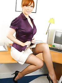 Saucy secretary in smart office outfit with light lingerie..