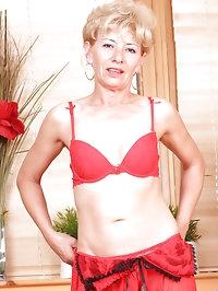 Seductive blonde milf bares her fair skinned mature body..
