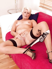 Seductive hot milf Sally Taylor satisfies her pussy with a..
