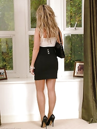 Stunning blonde Kathryn looks elegant in her short skirt..