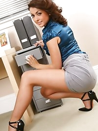 Naughty secretary shows a sexy strip in the office.