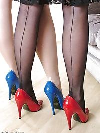 Two beautiful girls wearing multi coloured high heels