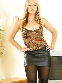 Mackenzie wearing a sexy miniskirt and long black boots..