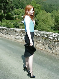 Cute redhead Miranda flashing her shiny stilettos and..