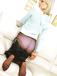 Beautiful blonde secretary slips out of her blue jumper..