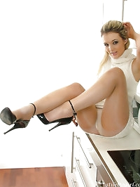 This slender blonde looks amazing in a white dress and..