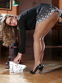 Office blonde in pantyhose showing her ass
