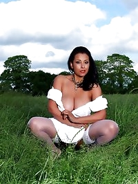 Danica Collins posing outdoors in loose cotton dress and..
