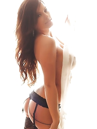 Alluring Vixen Candace glows in her black lace bra and..
