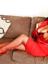 Danica in red fishnets and high heels playing with her dildo