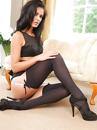 The gorgeous Emma D in black mini skirt and suspenders