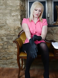 Horny blonde Axajay puts on a pair of sexy leather gloves,..