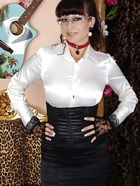 sexy busty rockabella emo girl in stockings and satin blouse