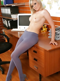 Cute blonde in purple pantyhose takes a break from work..