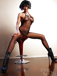 Leggy hot MILF in sexy body-stockings and boots