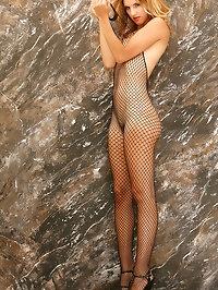 Wearing a full fishnet bodysuit Eva is letting it all hang..