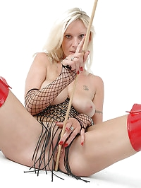 Horny blonde Milf in fishnet and long slutty red thigh..
