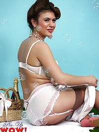 Beautiful brunette Kelly Hall strips in bubbles in the park.