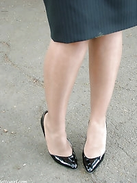 Black high heels make this sexy blondes feet look stunning